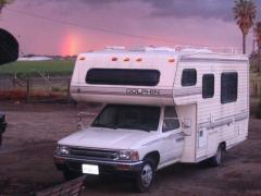 At the end of a rainbow is a Toyota Motor Home