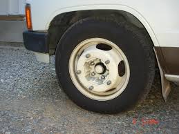 5-to-5 dually rim on front of toyota pickup.jpg
